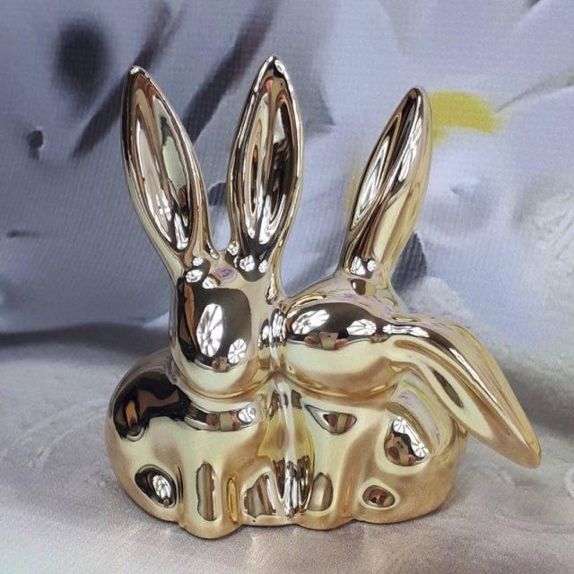Wielkanocne dekoracje domu para złotych zajęcy / zając złoty